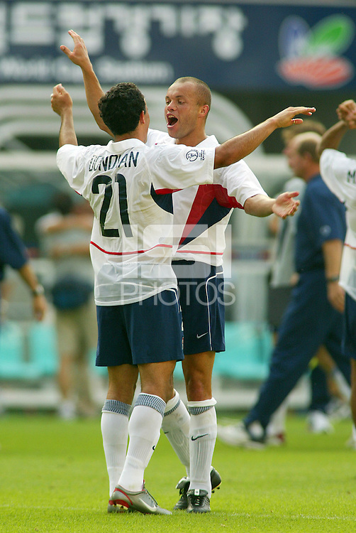 Landon Donovan is congratulated by Earnie Stewart for scoring the team's second goal. The USA defeated Mexico 2-0 in the Round of 16 of the FIFA World Cup 2002 in South Korea on June 17, 2002.