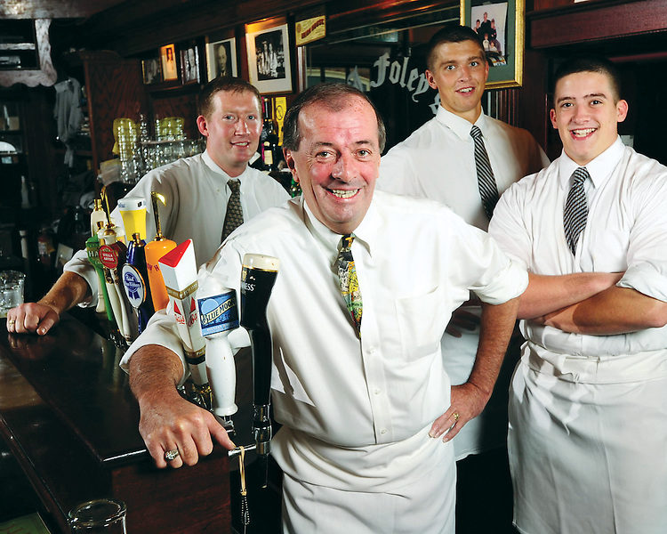 Jeremiah Foley is seen with his sons, Michael, left, Patrick, third from left, and Brendan, right, at the family's South End bar, J.J. Foley's on Friday,   September 11, 2009.