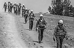 September 3, 1987 Pine Mountain Lake, California --Stanislaus Complex Fire -- Stanislaus National Forest firefighters trudge toward camp after long day's work. The Stanislaus Complex Fire consumed 28 structures and 145,980 acres.  One US Forest Service firefighter, David Ross Erickson, died from a tree-felling accident.