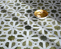 Jardin, a stone waterjet mosaic, shown in polished Verde Luna, Calacatta, and Carrara. Designed by Sara Baldwin for New Ravenna.<br />
