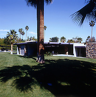 Palm trees tower over the entrance to this low-lying classic 1960s property in Palm Springs