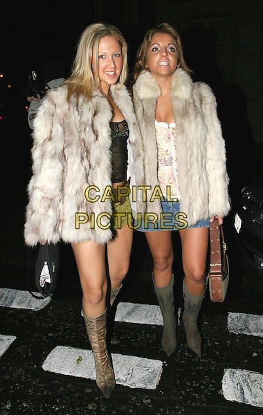 MILLION DOLLAR BABES.Loaded 2004 Calendar - launch party.full length, full-length, miniskirt, fur coat, knee high boots.www.capitalpictures.com.sales@capitalpictures.com.© Capital Pictures.