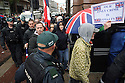 Police Officers escort Loyalist Flag Protesters away from a trade union rally against the G8 Summit in Belfast, Northern Ireland, 15 June 2013. Leaders from Canada, France, Germany, Italy, Japan, Russia, USA and UK are meeting at Lough Erne in Northern Ireland for the G8 Summit 17-18 June. Photo/STR