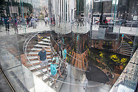 NEW YORK, NY - AUGUST 19: Some people walk down the glass stairs of the Apple store on Fifth Avenue on August 19 2020 in New York City. Tech giant Apple has become the first American company to boast a $2 trillion market value, after just two years becoming the first to reach $1 trillion (Photo by Pablo Monsalve / VIEWpress via Getty Images)