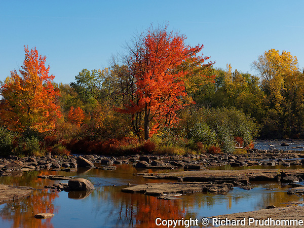 Fall colors along the Ouareau river in Saint-Liguori, Quebec