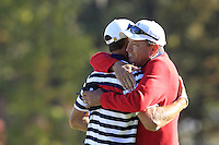 USA Team Player Dustin Johnson gets a hug from Captain Davis Love III after winning his match on the 16th green during Sunday's Singles Matches of the 39th Ryder Cup at Medinah Country Club, Chicago, Illinois 30th September 2012 (Photo Colum Watts/www.golffile.ie)