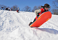 Luke George catches some air after going off of a jump near the top of the hill. 40 people were sledding Friday afternoon on the big hill behind the WARF soccer fields.