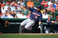Minnesota Twins left fielder Darin Mastroianni (21) slides home during a Spring Training game against the Baltimore Orioles on March 7, 2016 at Ed Smith Stadium in Sarasota, Florida.  Minnesota defeated Baltimore 3-0.  (Mike Janes/Four Seam Images)