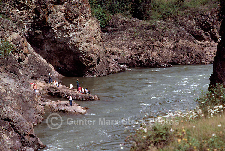 "Sports Fishermen fishing off ""Idiot Rock"" in the Bulkley River and Moricetown Canyon, near Moricetown, Northern BC, British Columbia, Canada"