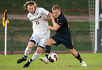 COLLEGE PARK, MD - NOVEMBER 03: Jack Hallahan #11 of Michigan and Matt Di Rosa #27 of Maryland fight for the ball during a game between Michigan and Maryland at Ludwig Field on November 03, 2019 in College Park, Maryland.