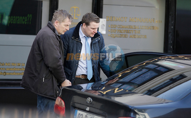 Aivers Sondors 51 Termonabbey drogheda<br /> <br /> Charged with allegedly moving the body of Audrius Butkus from 5 marsh road Drogheda to mornington beach 10/9/13<br /> <br /> Leaving Drogheda district court with Det SET Garda Gavin flood laytown.<br /> <br /> Picture: Fran Caffrey www.newsfile.ie<br /> Court Reporter Paul Murphy 0861944918