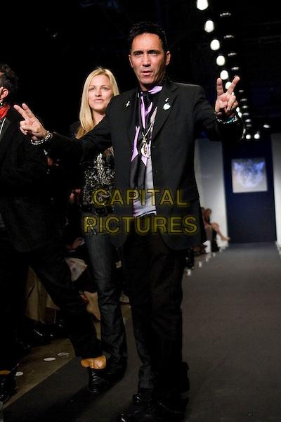 DESIGNER.Mercedes-Benz Spring 2007 L.A. Fashion Week - Life & Death - Runway held at Smashbox Studios, Culver City, California, USA..October 16th, 2006.Ref: ADM/ZL.catwalk modelling full length black suit hand gesture.www.capitalpictures.com.sales@capitalpictures.com.©Zach Lipp/AdMedia/Capital Pictures.