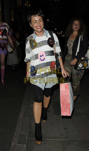 Jaime Winstone.The Louise Gray for Topshop launch party, Topshop Edited, Regent St., London, England..August 22nd, 2012.full length white red sequins sequined smiley faces print silver leggings black shirt denim stripe wood wooden heels platform shoes  orange gold pink goody bag.CAP/CAN.©Can Nguyen/Capital Pictures.