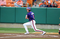 Clemson Tigers shortstop Tyler Krieger #3 swings at a pitch during a game against the Florida State Seminoles at Doug Kingsmore Stadium on March 22, 2014 in Clemson, South Carolina. The Seminoles defeated the Tigers 4-3. (Tony Farlow/Four Seam Images)