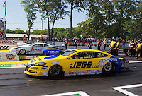 Jun. 1, 2014; Englishtown, NJ, USA; NHRA pro stock driver Jeg Coughlin Jr (near) defeats Greg Anderson in the final round of the Summernationals at Raceway Park. Mandatory Credit: Mark J. Rebilas-