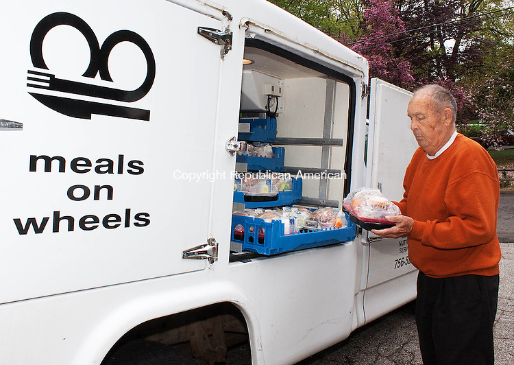 WOLCOTT CT-MAY 09 2013- 0050913DA13- George Lane, a driver for Meals on Wheels prepares to make a delivery in Wolcott on Thursday..Darlene Douty Republican American