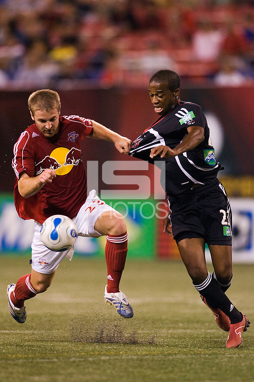 Red Bulls defender (23) Jeff Parke holds off DC United midfielder (23) Jamil Walker. DC United and the NY Red Bulls played to a 0-0 in an MLS regular season match at Giants Stadium, East Rutherford, NJ, August 16, 2006.