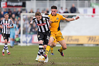 Elliott Hewitt of Notts County is challenged by Tom Owen-Evans of Newport County during the Sky Bet League 2 match between Newport County and Notts County at Rodney Parade, Newport, Wales on 6 May 2017. Photo by Mark  Hawkins / PRiME Media Images.