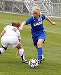 Danni Healy of South Dakota State dribbles the ball around the defense of Minnesota State Mankato's Elise Bjerkenas during their game on Thursday afternoon at the Fishback Soccer Complex in Brookings, SD. (Photo By Ty Carlson/SDSU Sports Information)