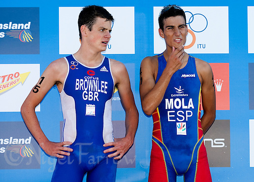 13 SEP 2009 - SOUTHPORT, AUS - Jonathan Brownlee (GBR) (left) talks with winner Mario Mola (ESP) before the medal ceremony for the  Junior Mens ITU World Triathlon Championships .(PHOTO (C) NIGEL FARROW)
