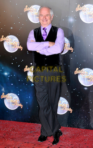 Johnny Ball.Strictly Come Dancing 2012 Series Launch at BBC Television Studios, London, England..September 11th 2012.full length black waistcoat trousers purple shirt arms crossed grey gray.CAP/ROS.©Steve Ross/Capital Pictures.