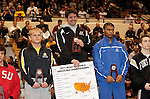 12 MAR 2011:  Nick Walpole of Indianapolis (in grey) on the podium with his award after defeating T.J. Hepburn of Nebraska-Kearney during the Division II Men's Wrestling Championship held at the UNK Health and Sports Center on the University of Nebraska - Kearney campus in Kearney, NE.   Walpole defeated Hepburn 4-2 to win the 149-lb national title. Scott Anderson/NCAA Photos