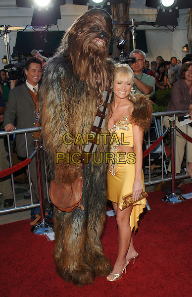 "CHEWBACCA & KATIE LOHMANN.""Star Wars: Episode III, ""Star Wars Episode III Revenge of The Sith"" Premiere to Benefit Artists for a New South Africa Charity held at Mann Village Theater. .March 5th, 2005.Photo Credit: Jacqui Wong/AdMedia.full length dress up costume yellow dress.www.capitalpictures.com.sales@capitalpictures.com.© Capital Pictures."