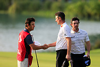 Harry Dimond Caddy, Justin Rose (ENG) and Rory McIlroy (NIR) on the 9th green during round 1 at the WGC HSBC Champions, Sheshan Golf Club, Shanghai, China. 31/10/2019.<br /> Picture Fran Caffrey / Golffile.ie<br /> <br /> All photo usage must carry mandatory copyright credit (© Golffile | Fran Caffrey)