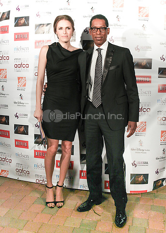 LOS ANGELES, CALIFORNIA - JANUARY 31: Orlando Jones, Jacqueline Staph at the African American Film Critics Association 5th Annual Awards Dinner on Friday Jan 31st, 2014  at the Taglyan Cultural Complex in Los Angeles, California. Photo Credit: RTNjohnson/MediaPunch.