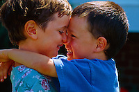 Four year old boy and girl hugging, Littleton, Colorado USA