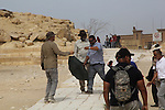 "Actor Morgan Freeman, is surrounded by his film crew as he visits the Giza Pyramids, just outside Cairo, Egypt, Friday, Oct. 23, 2015. Freeman is in Egypt to work on a National Geographic documentary titled, ""The Story of God."". Photo by Amr Sayed"