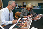 Historian Ron James and former first lady Dema Guinn sign prints of Steven Saylor's &quot;Nine Cheers for the Silver State&quot; artwork, at the Capitol, in Carson City, Nev., on Wednesday, Sept. 24, 2014. Dignitaries featured in the painting will sign the 150 limited edition prints which will be sold as a fundraiser for the Comstock Foundation for History and Culture.<br /> Photo by Cathleen Allison