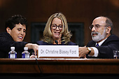 WASHINGTON, DC - SEPTEMBER 27:  Christine Blasey Ford (C) is assisted by her attorneys Debra Katz (L) and Michael Bromwich before testifying the Senate Judiciary Committee with in the Dirksen Senate Office Building on Capitol Hill September 27, 2018 in Washington, DC. A professor at Palo Alto University and a research psychologist at the Stanford University School of Medicine, Ford has accused Supreme Court nominee Judge Brett Kavanaugh of sexually assaulting her during a party in 1982 when they were high school students in suburban Maryland. In prepared remarks, Ford said, ÒI donÕt have all the answers, and I donÕt remember as much as I would like to. But the details about that night that bring me here today are ones I will never forget. They have been seared into my memory and have haunted me episodically as an adult.Ó  (Photo by Win McNamee/Getty Images)