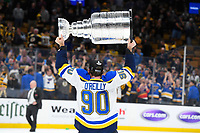 June 12, 2019: St. Louis Blues center Ryan O'Reilly (90) hoists the Stanley Cup for fans at game 7 of the NHL Stanley Cup Finals between the St Louis Blues and the Boston Bruins held at TD Garden, in Boston, Mass. The Saint Louis Blues defeat the Boston Bruins 4-1 in game 7 to win the 2019 Stanley Cup Championship.  Eric Canha/CSM