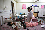 A nurse checks the movement of the baby using a Cardio Tocogram in the maternity ward of the Duncan Hospital in Raxaul, Bihar, India.