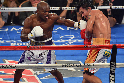 09.04.2016, Las Vegas, Nevada, USA. Timothy Bradley, Jr. (L) (USA) throws a punch during the Pacquiao versus Bradley Welterweight Championship fight in the MGM Grand Garden Arena at the MGM Grand Hotel and Casino in Las Vegas, Nevada. Manny Pacquiao (Philippines) defeated Timothy Bradley, Jr. (USA) by unanimous decision.