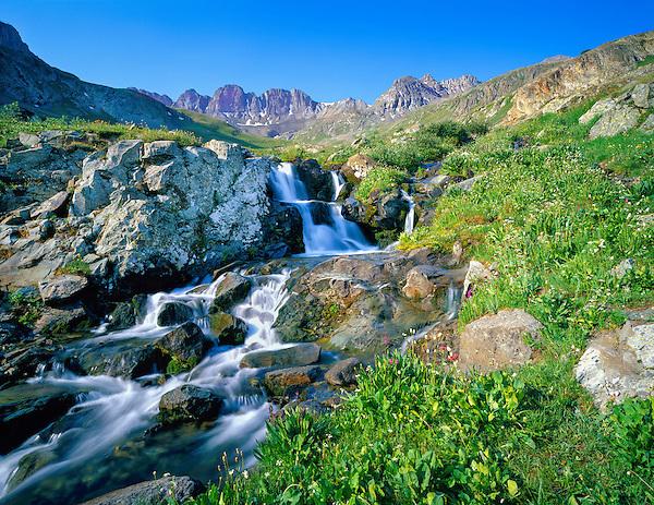 Waterfall in American Basin, San Juan Mountains, Colorado, .  John leads wildflower photo tours into American Basin and throughout Colorado. All-year long.