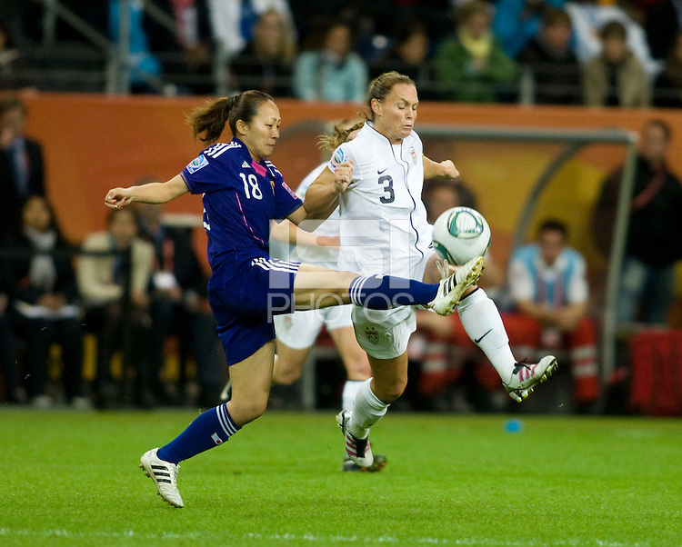 Christie Rampone (3) of the United States clears the ball away from Karina Maruyama (18) of Japan during the final of the FIFA Women's World Cup at FIFA Women's World Cup Stadium in Frankfurt Germany.  Japan won the FIFA Women's World Cup on penalty kicks after tying the United States, 2-2, in extra time.