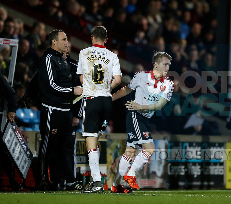 Louis Reed of Sheffield Utd replaces Chris Basham of Sheffield Utd - English League One - Scunthorpe Utd vs Sheffield Utd - Glandford Park Stadium - Scunthorpe - England - 19th December 2015 - Pic Simon Bellis/Sportimage