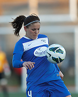 Boston Breakers defender Cat Whitehill (4) traps the ball. In a National Women's Soccer League Elite (NWSL) match, the Boston Breakers (blue) tied the Washington Spirit (white), 1-1, at Dilboy Stadium on April 14, 2012.