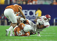 NWA Media/Michael Woods --12/29/2014-- w @NWAMICHAELW...University of Arkansas receiver Demetrius Wilson is tackled by Texas defenders after a reception in the 3rd quarter during the Texas Bowl Monday night at  NRG Stadium in Houston.