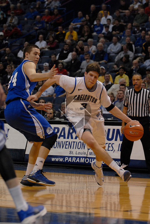 Creighton Bluejays forward Doug McDermott (3) drives past Drake Bulldogs forward Joey King (24) in the first quarterfinal game of the Missouri Valley Conference Tournament. The Creighton University Bluejays defeated the Drake Bulldogs 65-53 on Friday March 8, 2013 at the Scottrade Center in St. Louis, Missouri.