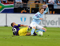 Thursday 08 August 2013<br /> Pictured L-R: Ashley Richards of Swansea bringing down Emil Forsberg of Malmo. <br /> Re: Malmo FF v Swansea City FC, UEFA Europa League 3rd Qualifying Round, Second Leg, at the Swedbank Stadium, Malmo, Sweden.
