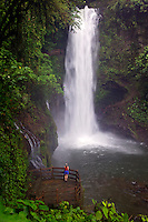 A visitor (mr) views the La Paz river and the Magia Blanca Falls along the trails at the La Paz Waterfall Gardens and Peace Lodge, Costa Rica