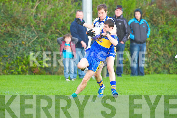 St Senans Darragh Kennelly tries to get away from Keel's Emmett Ashe in the division 4 clash at Keel on Saturday.