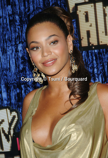 Beyonce Knowles at the MTV vma  Awards at the  at the The Palms Casino Resort in Las Vegas.<br /> <br /> headshot<br /> fashion<br /> gold dress<br /> gold tunique dress<br /> headshot<br /> cleavage