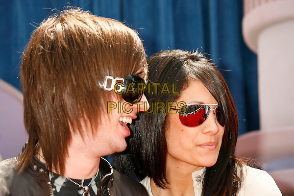 "NICK WHEELER of The All-American Rejects and guest.Attending the ""Meet The Robinsons"" Los Angeles Premiere held at the El Capitan Theatre, Hollywood, California, USA, 25 March 2007..portrait headshto D & G sunglasses Dolce and Gabbana.CAP/ADM/RE.©Russ Elliot/AdMedia/Capital Pictures."