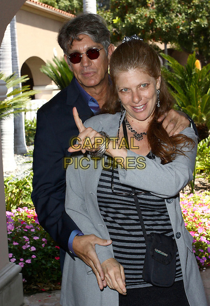 ERIC ROBERTS & ELIZA ROBERTS.2009 Cable's Summer Press Tour_Day2 Held at The Langham Huntington Hotel & Spa, Pasadena, California, USA..July 29th, 2009.half length blue suit sunglasses shades grey gray striped stripes jacket arms around waist hug embrace married husband wife hand finger .CAP/ADM/TC.©T. Conrad/AdMedia/Capital Pictures.