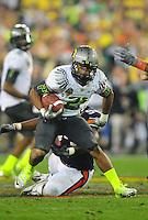 Jan 10, 2011; Glendale, AZ, USA; Oregon Ducks running back LaMichael James (21) during the 2011 BCS National Championship game against the Auburn Tigers at University of Phoenix Stadium. The Tigers defeated the Ducks 22-19. Mandatory Credit: Mark J. Rebilas-