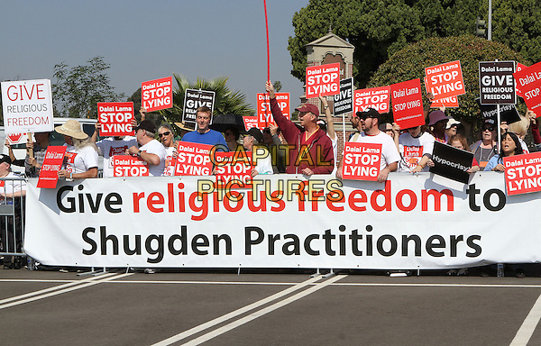 25 February 2014 - Los Angeles, California - Protesters, The International Shugden Community.  His Holiness the 14th Dalai Lama of Tibet &quot;21st Century Compassion&quot; public speaking event held at the LA Forum.<br /> CAP/ADM/RE<br /> &copy;Russ Elliot/AdMedia/Capital Pictures